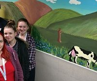Uxbridge College Students and one of their murals